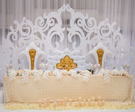 Exquisitely decorated wedding table setting with candles and bou Royalty Free Stock Images