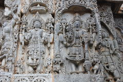 Exquisitely ornated relief carvings on outer wall of Hoysaleswara Temple. Halebidu, Karnataka, India which was built in 12th century by hoysala empire Stock Images