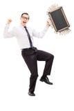 Extatische zakenman met aktentashoogtepunt van geld Royalty-vrije Stock Foto
