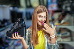Extcited woman in shoe store Stock Photos