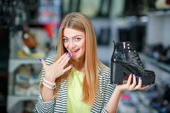 Extcited woman in shoe store Stock Photo
