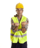 Extend. A longshoreman, making maneuvering signals to the crane Stock Photo