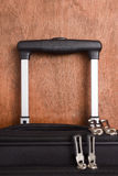Extendable handle suitcase traveler. Royalty Free Stock Images