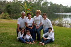 Extende family by lake Royalty Free Stock Image