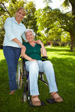 Extended care for senior woman. Extended care for disabled senior women in wheelchair royalty free stock photo