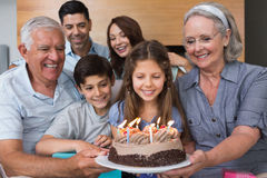 Extended family with cake in the living room Stock Image