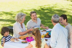 Extended family dining at outdoor table Stock Images