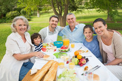Extended family dining at outdoor table Royalty Free Stock Photography