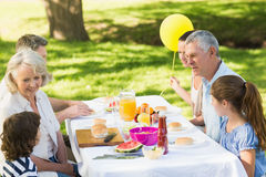 Extended family dining at outdoor table Stock Photos