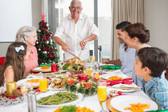 Extended family at dining table for christmas dinner in house Stock Image