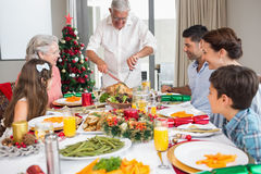 Extended family at dining table for christmas dinner Royalty Free Stock Image
