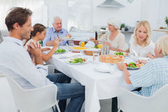 Extended family at the dinner table. In kitchen Royalty Free Stock Images