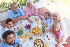 Extended family eating outdoors Royalty Free Stock Photo