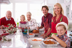 Extended Family Group Basting Christmas Turkey In Kitchen Royalty Free Stock Photos
