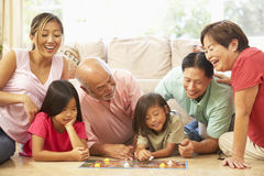 Extended Family Group Playing Board Game. At Home royalty free stock photo