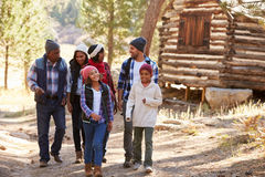 Extended Family Group On Walk Through Woods In Fall stock photography