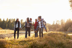 Extended Family Group Walking By Lake Royalty Free Stock Photography