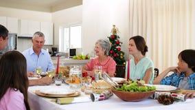 Extended family having christmas dinner together stock video