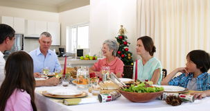 Extended family having christmas dinner together Royalty Free Stock Photos