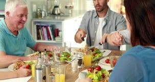 Extended family having dinner. At home stock video