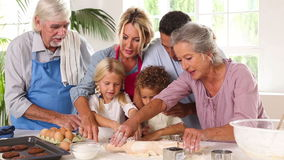 Extended family having fun while baking stock footage