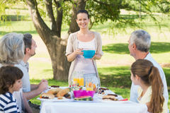 Extended family having lunch in lawn Royalty Free Stock Image