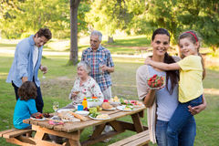 Extended family having an outdoor lunch. On a sunny day Royalty Free Stock Photography