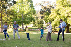 Extended family having tug of war. On a sunny day Royalty Free Stock Images