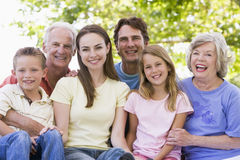 Extended family outdoors smiling Royalty Free Stock Photos