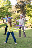 Extended family playing with hula hoops Royalty Free Stock Image