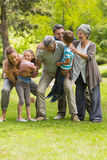 Extended family playing in park Stock Photography