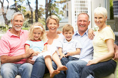 Extended Family Relaxing In Garden Royalty Free Stock Photography