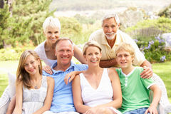 Extended Family Relaxing In Garden Stock Photos