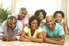 Extended Family Relaxing At Home Together. Lying on The Floor Royalty Free Stock Photo