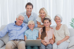 Extended family sitting on couch Stock Photos