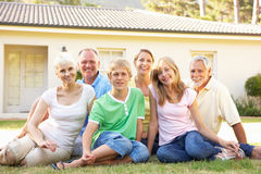 Extended Family Sitting Outside Dream Home Stock Photography
