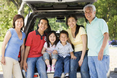 Extended family sitting in tailgate of car royalty free stock images