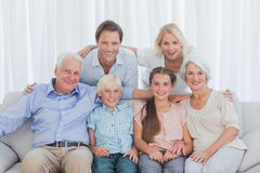 Extended family sitting together on couch Stock Images