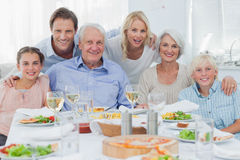 Extended family smiling at dinner family Stock Images