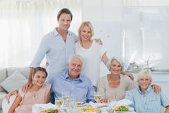 Extended family smiling at the dinner table Stock Images