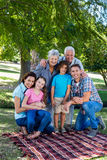 Extended family smiling in the park Stock Photography