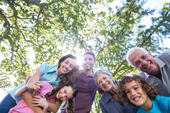 Extended family smiling in the park Stock Photo