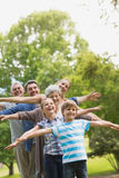 Extended family stretching hands at park Stock Image
