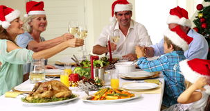 Extended family toasting at christmas dinner stock video footage