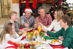 Extended family toasting at christmas dinner Royalty Free Stock Image