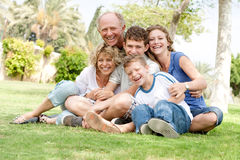 Extended group portrait of family. Enjoying day in park Royalty Free Stock Photos