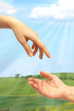 Extended hand for help in nature stock photos