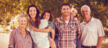 Extended happy family standing together in park Stock Image