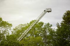 Extended firefighting ladder to sky royalty free stock image