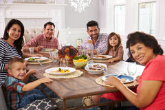 Extended Hispanic Family Enjoying Meal At Table Stock Photos